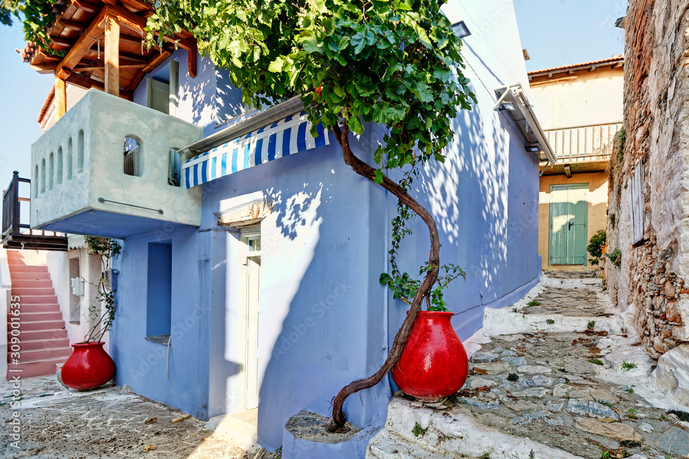 Picturesque alley in the old Chora of Alonissos, Greece