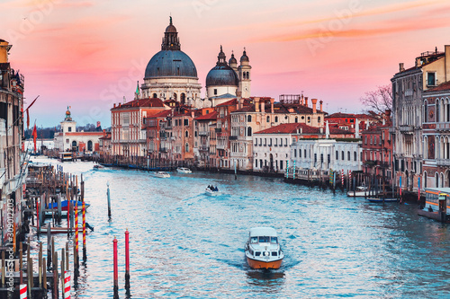 Spoed Fotobehang Gondolas Cathedral Santa Maria della Salute tourists on gondola Grand Canal of Venice sunset, Italy