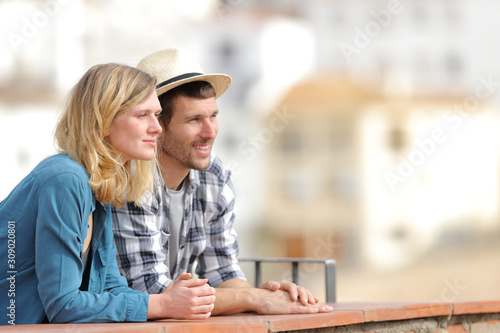 Relaxed tourists sightseeing contemplating views from a balcony Wallpaper Mural