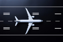 Aircraft Model On Runway, Top View. Concept Of Aircraft Industry, Airline Safety, Security And Traveling Insurance