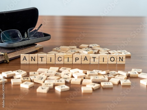 Photo anticipation the word or concept represented by wooden letter tiles