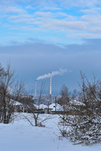 City Landscape. Trees Covered With Snow. Chimney With Smoke In Residents Area. Ecological Concept Image.