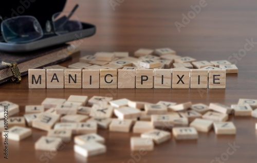 Vászonkép manic pixie the word or concept represented by wooden letter tiles