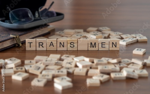 trans men the word or concept represented by wooden letter tiles Wallpaper Mural