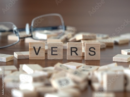 vers the word or concept represented by wooden letter tiles Wallpaper Mural