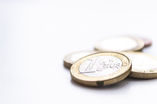 Several Euro Coins On Light Blurred Background. Closeup Photo
