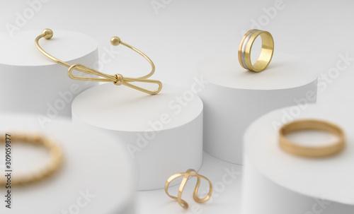 Fotografía Modern Golden bow shape bracelet and rings collection on white cylinders platfor