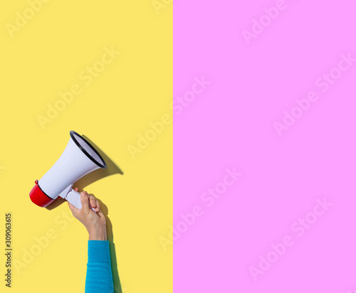 Person holding a megaphone with hard shadow Canvas Print