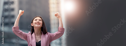 Fotomural Power of woman, young Asian businesswoman raised arms motivates herself with  confident