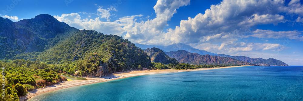 Fototapeta Summer mediterranean coastal landscape - view of the Cirali Olympos Beach, near the Turkish village of Cıralı, Antalya Province in Turkey