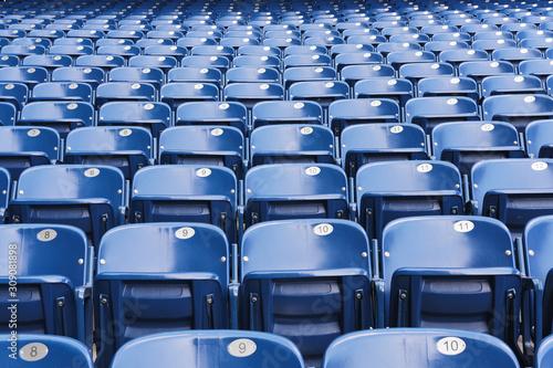 Empty blue stadium seats, empty bleachers Fototapet
