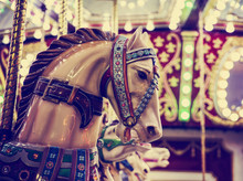 Merry-go-round Wooden Horses Toned With A Retro Vintage Instagram Filter App Or Action Effect (SHALLOW DOF)