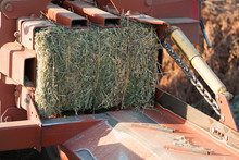 Red Hay Alfalfa Bailing Tractor With Bail Finished.