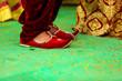 Leinwanddruck Bild - Traditional indian wedding ceremony : Groom puts on  wedding shoes