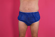 canvas print picture - torso of a man in big blue shorts