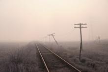 Railway Tracks On Frozen Misty...