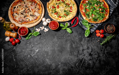 Traditional Italian pizza, vegetables, ingredients on a dark background. Top ...