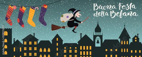 Fototapeta Hand drawn vector illustration with witch Befana flying on broomstick over city, stockings, Italian text Buona Festa della Befana, Happy Epiphany