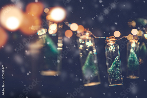 Close-up, Elegant Christmas tree in glass jar with snowflakes background, copy space, Christmas concept. - 309129847