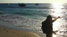 Female Traveler Walking Barefo...