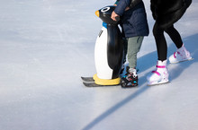 Ice Rink. Mom Teaches A Child ...