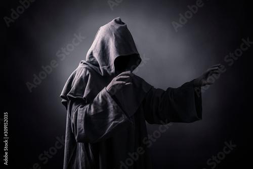 Tela Scary figure in hooded cloak