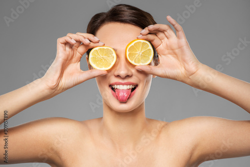beauty, skin care and detox concept - beautiful woman making eye mask of lemon s Wallpaper Mural
