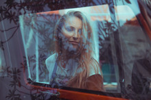 Beautiful Blonde Girl In Modern Fashion On A Background Of Palm Trees, A Hippie Car. Dissolute Girl With Happy Emotions.