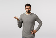 I Dont Know. Perplexed, Indecisive Clueless Handsome Bearded Boyfriend In Grey Sweater, Cant Figure Out What Best Buy, Where Shop, Raise One Hand And Shrugging, Smirk Puzzled, White Background
