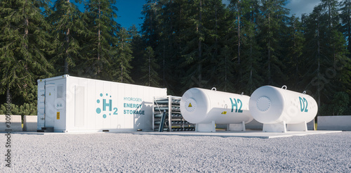 Fotografía Environmentally friendly solution of renewable energy storage - hydrogen gas to clean electricity facility situated in forest environment