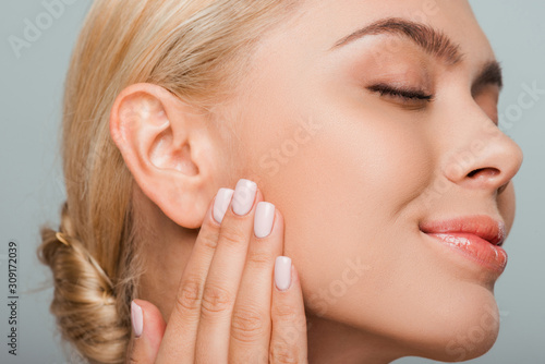 attractive woman with blush on cheek isolated on grey Tablou Canvas