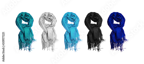 Cashmere scarves in winter cold colors isolated on white background. Warm scarf