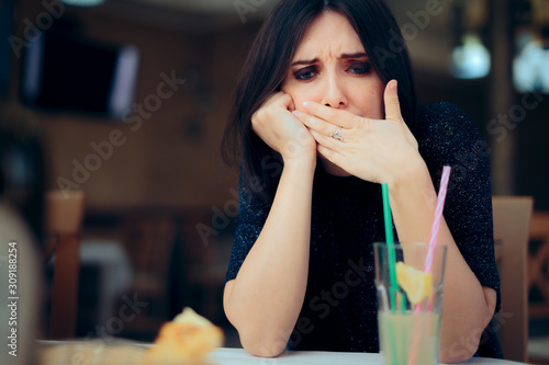 Nauseated Woman Feeling Sick at the Restaurant Tablou Canvas