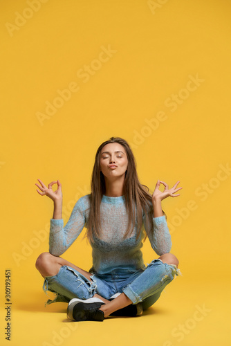 Obraz Front view of girl showing peace. - fototapety do salonu