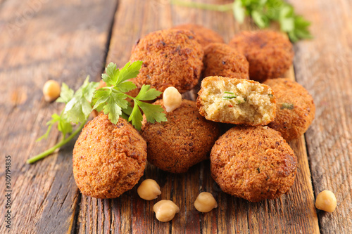 Cuadros en Lienzo fried falafel with herb on wood background
