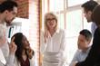 Leinwanddruck Bild - Boss defines tasks and corporate goals for staff at meeting