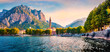 Beautiful morning cityscape of central park of Lecco town, Italy, Europe. Colorful summer sunrise on Como lake. Traveling concept background.