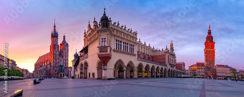 Fototapeta Panorama of Medieval Main market square with Basilica of Saint Mary, Cloth Hall and Town Hall Tower in Old Town of Krakow at sunrise, Poland obraz