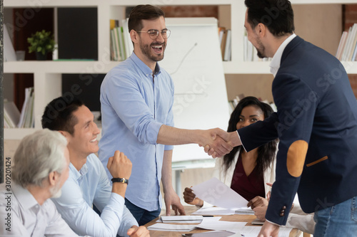 Successful business partners shaking hands starting or finished meeting Wallpaper Mural