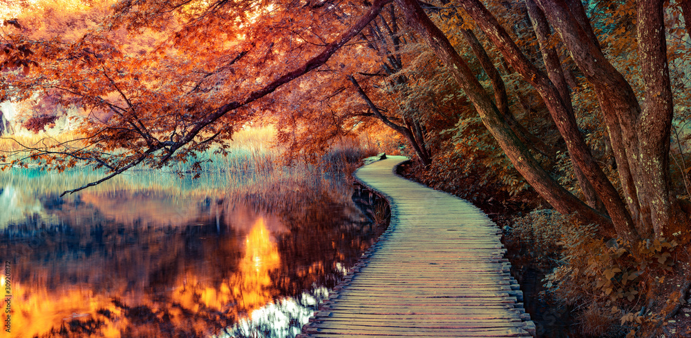 Fototapeta Infrared filtered view of Plitvice Lakes National Park. Splendid summer scene with footbridge on the pure water lake. Picturesque countryside view of Croatia, Europe.