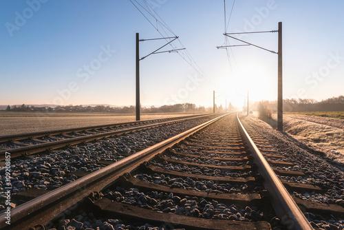 Fototapeta Railroad tracks and frosty landscape. Rail tracks at sunrise obraz
