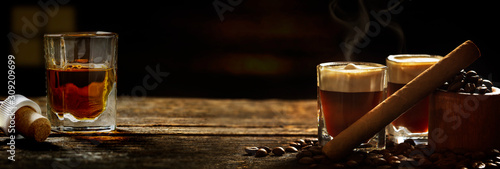 Irish coffee - coffee and whiskey and cigars against dark background Wallpaper Mural