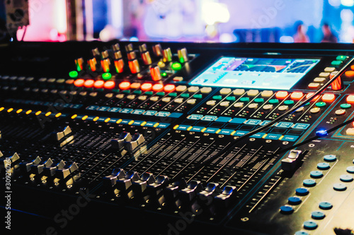 Closeup of an audio mixing control panel - 309210261