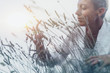 Abundance Concept. Mindful Woman Feeling Good, Enjoying the Scent of Lavender Flowers
