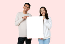 Close Up Young Lover Asian People Standing With Happiness Smiling And Holding White Mockup Board Together (for Add Content) Isolated On Pale Pink Color Background For Valentine Day , Family  Lifestyle