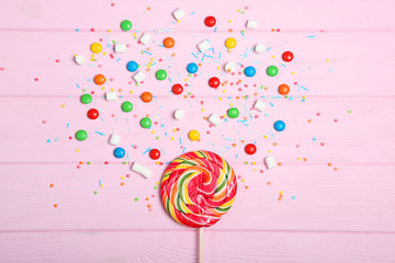 Candies and sweets on a colored background top view with place for text.