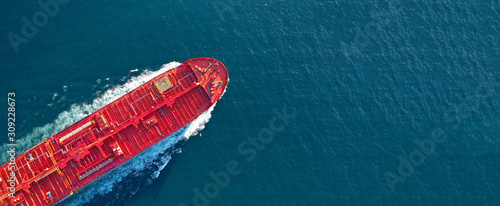 Fototapeta Aerial drone ultra wide panoramic photo of industrial fuel and petrochemical tanker cruising open ocean deep blue sea obraz