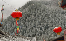 Traditional Chinese Red Lanterns Against Winter Mountain Landscape.