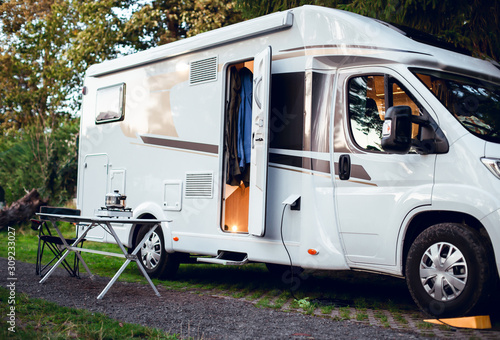 Cuadros en Lienzo White motor home parked in camping in the woods with the door open