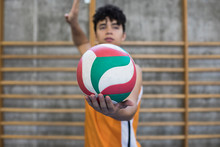 Man Holding A Volleyball Ball ...